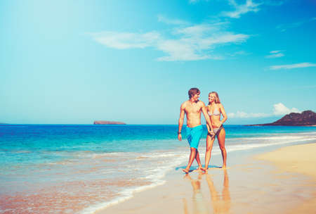 Happy Attractive Young Couple on Tropical Beach Reklamní fotografie
