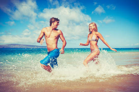 Happy Attractive Young Couple on Tropical Beach Stock fotó