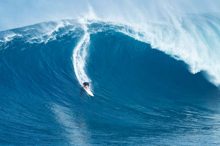 MAUI, HI - JANUARY 16 2016: Professional surfer Shaun Stodder rides a giant wave at the legendary big wave surf break known as Jaws on one the largest swells of the year. Redakční