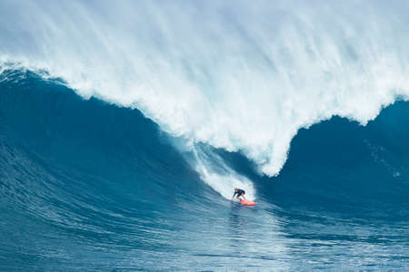 MAUI, HI - JANUARY 16 2016: Professional surfer Will Hunt rides a giant wave at the legendary big wave surf break known as Jaws on one the largest swells of the year. Redakční