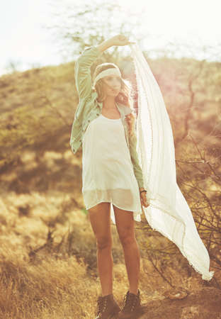 Fashion Lifestyle. Fashion Portrait of Beautiful Young Woman Outdoors. Soft warm vintage color tone. Artsy Bohemian Style.