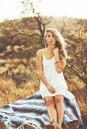 Fashion Lifestyle. Fashion Portrait of Beautiful Young Woman Outdoors. Soft warm vintage color tone. Artsy Bohemian Style. photo