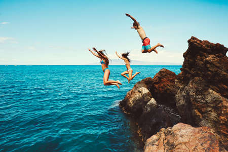 Cliff jumping into the ocean, summer fun adventure lifestyle Stock Photo - 89478690