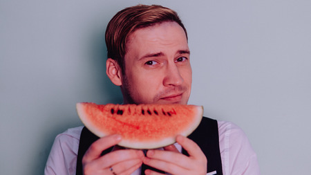 A man and a watermelon / Boy in classic suit with a watermelon