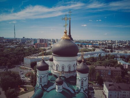 Domes with golden crosses of the Orthodox Church, blue sky