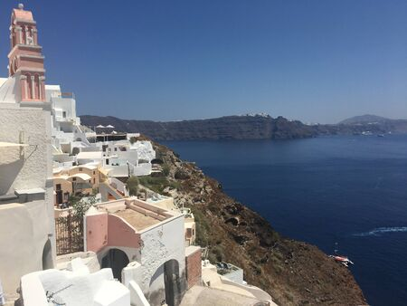 White architectural houses in greek village of Santorini on a sunny day Фото со стока