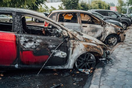 Vandalism or revenge, burnt car. The consequences of popular protest, burnt car, a crime. Car after fire. Auto trash