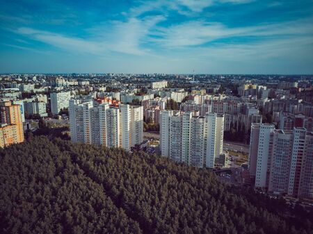 Residential building surrounded by trees. Skyscrapers in the forest environment