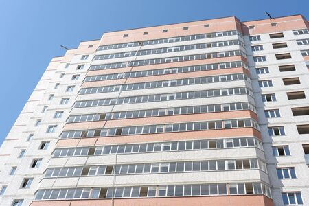 Modern apartment buildings on a sunny day with a blue sky. Facade of a modern apartment building. residential building modern apartment condominium architecture
