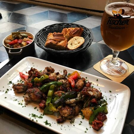 Food photography. An appetizing meat dish with vegetables and beer