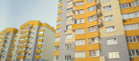 Modern multistory apartment building. Contemporary architecture. Building fragment.