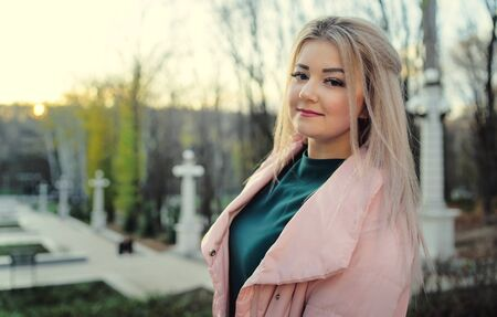 A portrait of a beautiful girl, walking in the autumn park