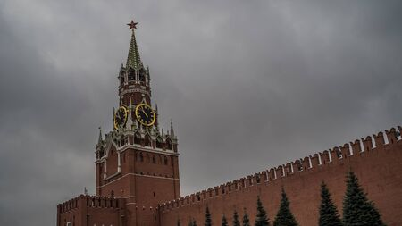 The tower of the Moscow Kremlin against the gray sky