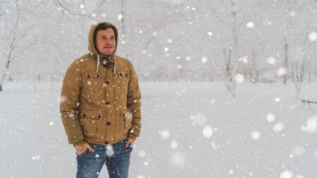 Portrait of young man in jacket and jeans in winter season.