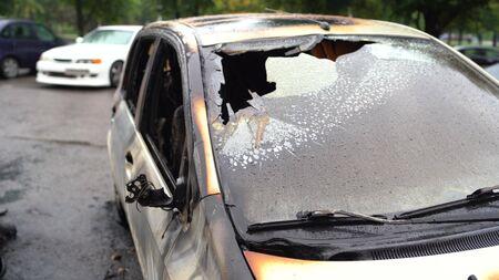 Vandalism or revenge, burnt car. The consequences of popular protest, burnt car, a crime.