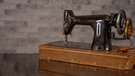 Close up of old manual sewing machine on table