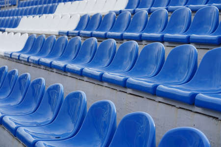 Bleachers in a sports stadium. White and blue seats in a large street stadium Imagens