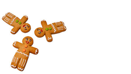 Close up of gingerbread men on isolated white background. Festive decorative gingerbreads for Christmas mood with space for your text. Concept of classic cookie on holiday