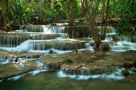 Deep forest waterfall ay Huay Mae Kamin Kanjanabri Thailand photo