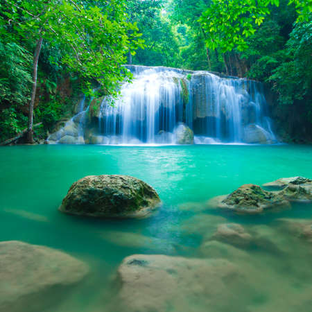 background waterfalls: Blue stream waterfall at Erawan waterfall National Park Kanjanaburi Thailand Stock Photo