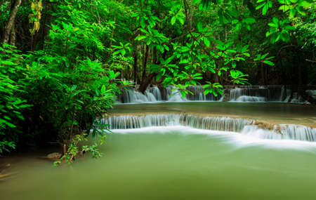 Deep forest waterfall at Huay Mae Kamin waterfall National Park Kanjanaburi Thailand