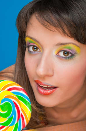 sugarplum: portrait of beautiful girl with big lollipop  Stock Photo