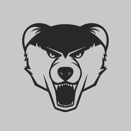 one color: The bear bares its teeth. Bear head logo or icon in one color. Vector illustration.