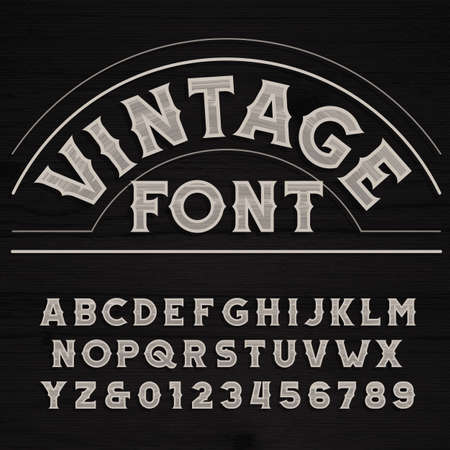 Vintage font. Retro alphabet. Dirty letters on a grunge wooden background.