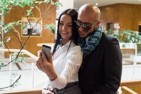 table skirt: Arab businessman and girl making selfie in the shopping center