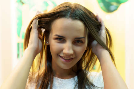 Positive young european model smiling and looking at camera