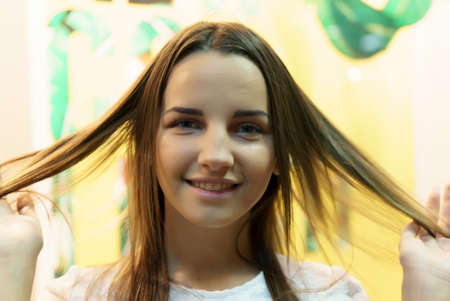 facial features: Attractive young european model smiling and posing for camera. Close-up