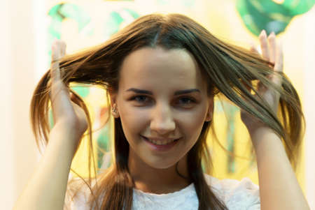 Attractive young european model smiling and posing for camera. Close-up