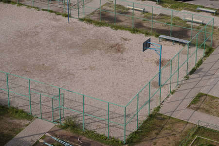 Basketball ring. School sports court or schoolyard for different activities in summer