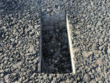 Place of selection of the kernel in the form of a rectangular from asphalt concrete pavement. Kern. Close-up Stock fotó