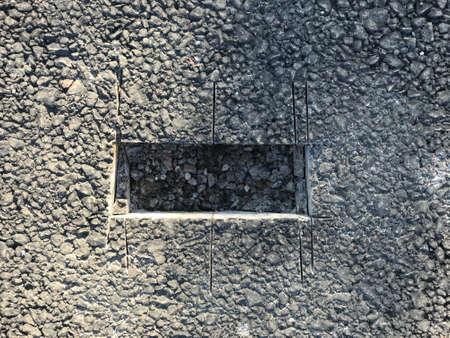 Place of sampling the asphalt coating in the form of a rectangular from asphalt concrete pavement. Kern. Close-up