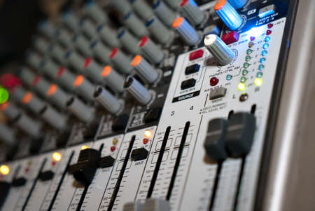 Audio mixer for adjusting quality of music at a nightclub. Close-up Stock fotó