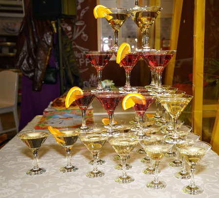 Beautiful shelves of glasses of red and white wine at a wedding party. Close-up Stock fotó