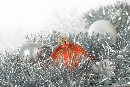 blanch: red, silver and blanch christmas balls and a pair of snowflakes on silver tinsel
