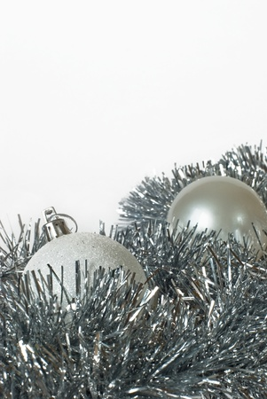 blanch: white and silver christmas balls on silver tinsel Stock Photo