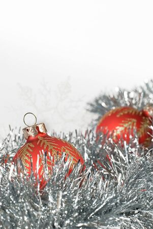 blanch: a pair of red christmas balls and a pair of snowflakes on silver tinsel