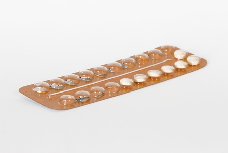 Birth control pills on white Stock Photo - 16889655
