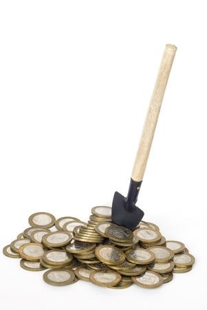 gold shovel: Metal money and shovel on white background