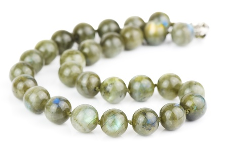 labradorite: necklace of large labradorite beads on a white background Stock Photo