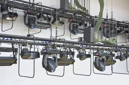 two rows of lighting devices on stage rigging photo