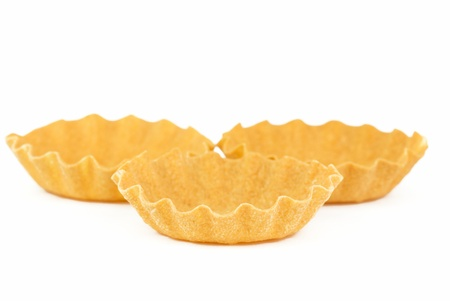 insipid: three empty tartlet on white background