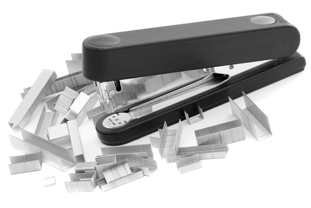 staples: Black stapler and staples are many different Stock Photo