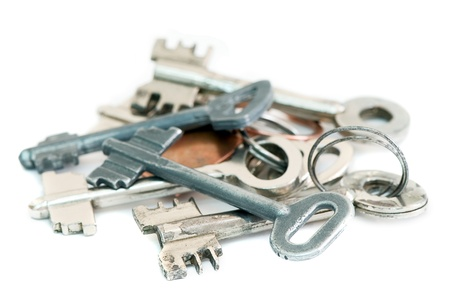 pile of old metal keys on a white background photo