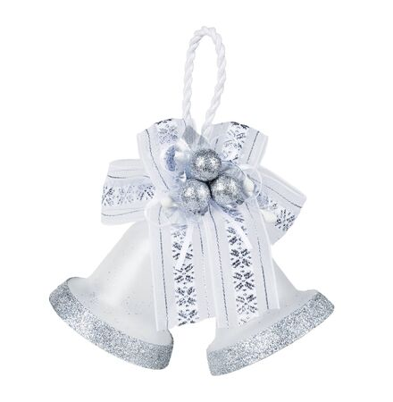 silver bells: pair of silver bells with bow Stock Photo