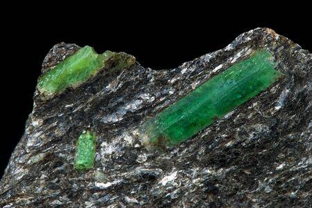 beryl: emerald jewel in the matrix on a black background