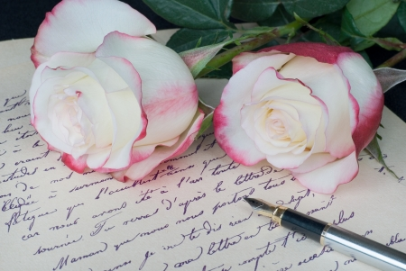still life with an old letter, pen and and two beautiful roses